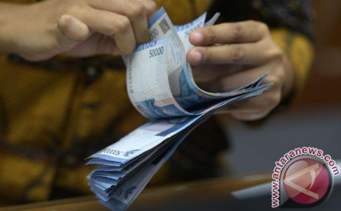 Rupiah Melemah Tipis Menjadi Rp. 14.600 Per Dollar AS
